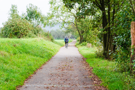 ruhr: ESSEN, GERMANY - September 30, 2014: Group of older men cycling on the promenade of the river Ruhr near Essen Werden towards Kettwig. Editorial