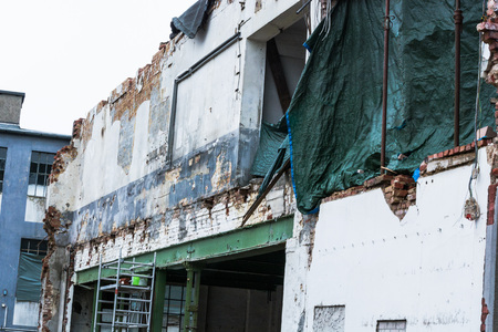 urban environments: Demolition of a building in urban environments. House in ruins. Stock Photo