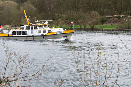 work boat: ESSEN, NRW, GERMANY - APRIL 4, 2016: River supervisor boat Bussard MS at a check ride on the river Ruhr in Germany. Boat in use for water protection. Editorial