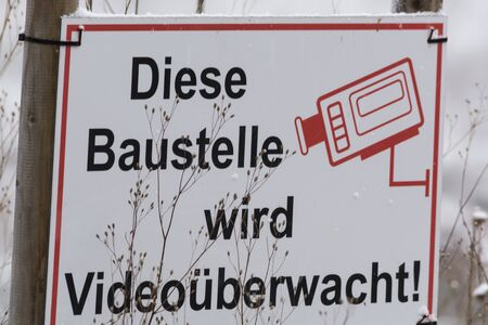 monitored: Construction sign with caption in German This construction is Video Monitored