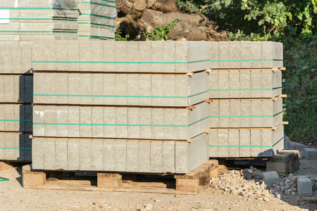 building material: Building material: Stacked paving stones on wooden pallet.