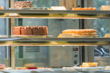 pound cake: Cake shop a wide range of different Cake in a glass case.