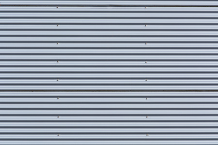 sheet metal: Silver-colored metal wall corrugated sheet metal background.