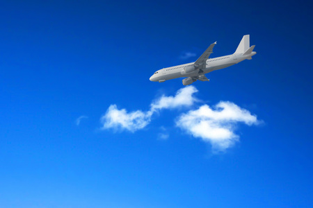 Intentional blur; Photoshop editing Airliner landing against a blue sky.