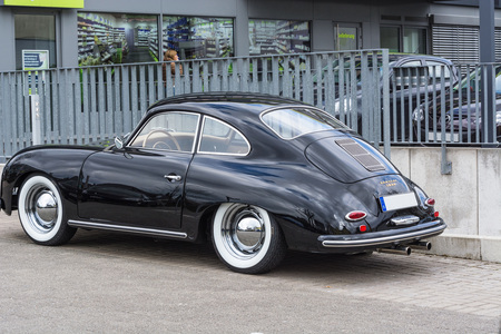 dean: VELBERT, NRW, GERMANY - APRIL 06, 2016: Black vintage Porsche 1600 with whitewall tires on a car park in Velbert city center, Germany. Editorial