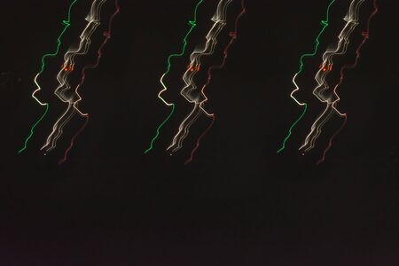 Abstract dynamic lighting effects, light stripes on black background.