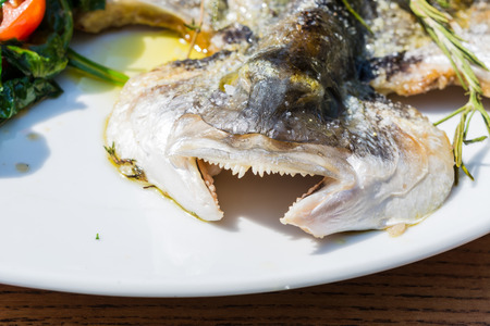 dorade: Fresh fish sea bream, bream with salt, herbs and pepper prepares grilled.