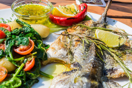 sea bream: Fresh fish sea bream, bream with salt, herbs and pepper prepares grilled.
