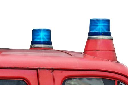 antique fire truck: Two flashing blue lights on a fire truck.