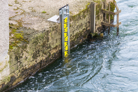 depth measurement: Water level indicator for monitoring the water level. Stock Photo