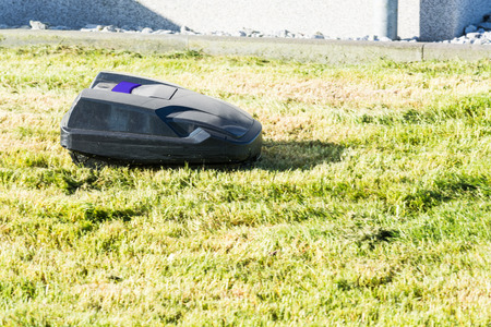 Lawnmower robot, automatic lawn mower that mows the lawn in a garden Stock Photo