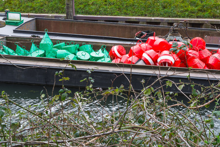 tonne: Red and green buoys as marking the shipping waterway.