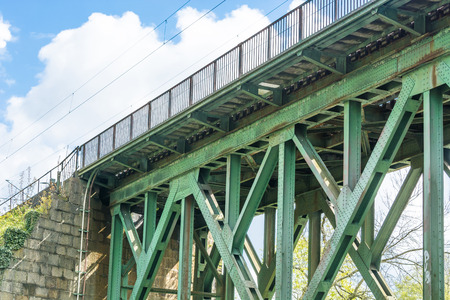 Former old riveted railway bridge of steel for pedestrians and cyclists on the Ruhr in Essen Kupferdreh.