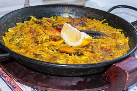 marisco: Valencia paella with seafood and fresh lobster, calamari.