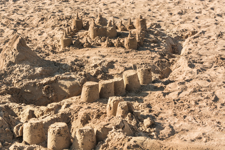 impermanent: Closeup of a sandcastle on a sandy beach Stock Photo