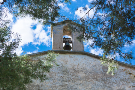 spanish style: Bell in Spanish style against a blue sky. Stock Photo