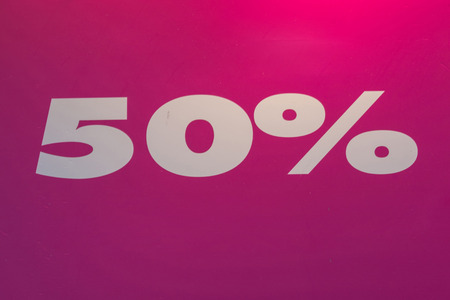 Sign with the number 50% discount on red background.