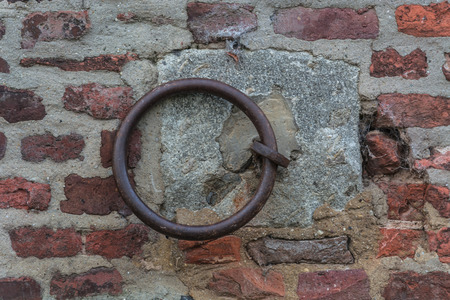 earlier: Iron ring on a wall, used earlier fasten the horses.