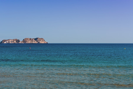 waters: Views of the Bay of Paguera with a sandy beach and azure waters, Mallorca, Spain.