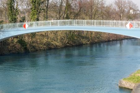 Pedestrian bridge steel arch structure over the river Ruhr in Muelheim, Germany.
