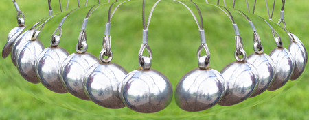gravitational: So Newtons Cradle or pendulum ball, Newton pendulum called Newtons cradle.Physics is action, reaction and concept or cause and effect. Stock Photo