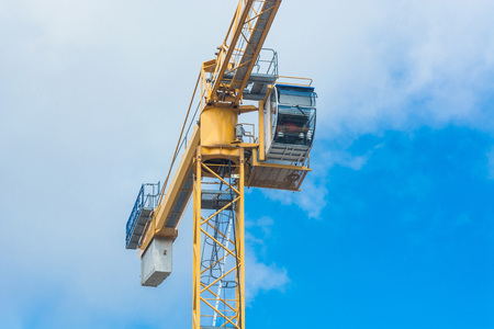 Part of a construction crane against blue sky photographed, space for labeling.