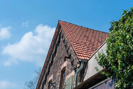 House with stone gable made of brick in Germany.
