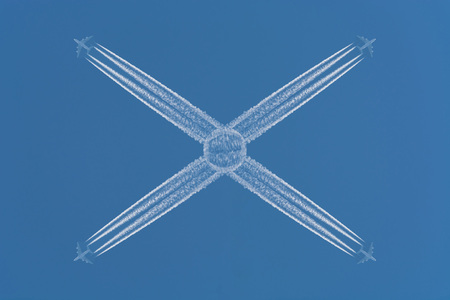 business life line: Four planes flying at high altitude. Contrails against a dark blue sky.