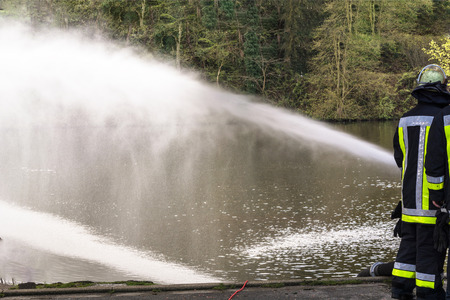 extinguishing: Fire department sprayed extinguishing water from firehoses during at exercise.