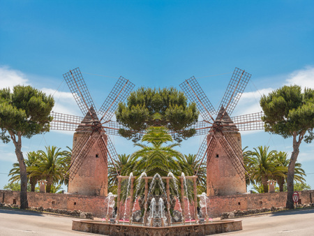 Photomontage, two old historic windmill at a country estate in Mallorca (Spain) Stock Photo