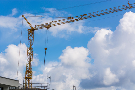 Construction crane against blue sky photographed, space for labeling. Stock Photo