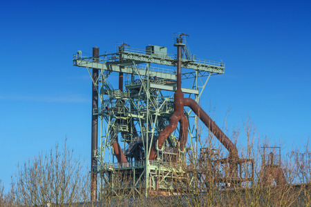 View blast furnace of an old steel mill before blue sky.