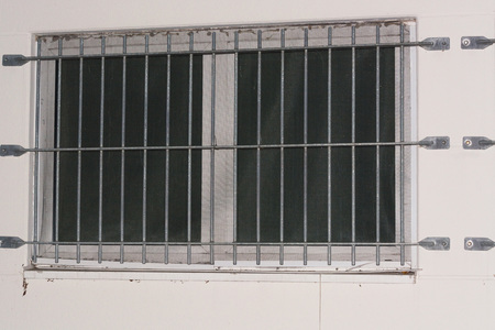 part prison: Installation of window grid of metal as protection against intruders. Security grille for windows, doors and balconies.