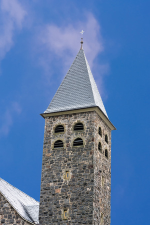 Tower, spire of a church in Antfeld in Sauerland, Germany against blue sky. Stock Photo