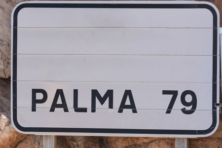 majorca: Road sign in Spain. Give the distance to the places Arta and Palma. Recording in Mallorca, Spain. Caption in Spanish.