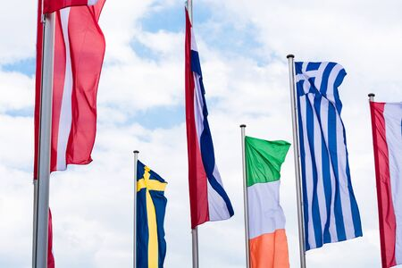 Several Europe countries flags arranged in front of a blue sky. Stock Photo
