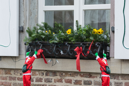 light chains: Christmas decoration with fir branches a windowsill outside.