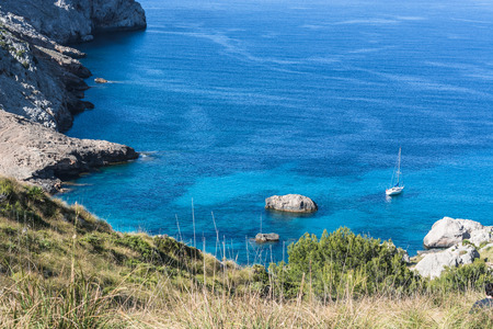 baleares: Picturesque sea landscape with bay and sailing ship on Mallorca, Baleares in Spain.