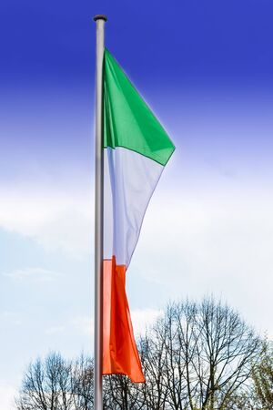 Italy flags on a flagpole against white background