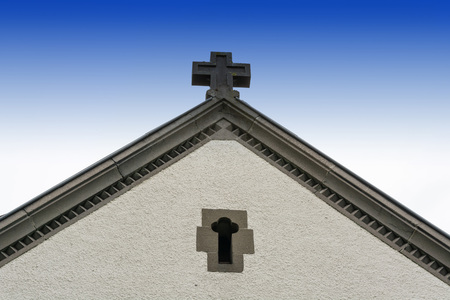 House gable, Mediterranean building with cross Stock Photo