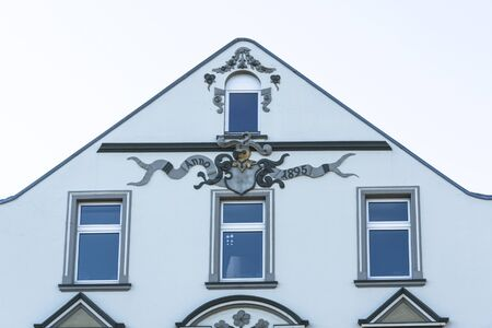 house gables: Old house facade with various stucco decorations