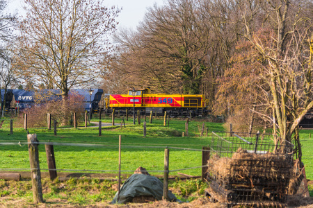 propelled: RATINGEN, NRW, GERMANY - DECEMBER 28, 2015: Locomotive at the railroad crossing in Ratingen at the moated castle house to house. By propelled fast train towards Muelheim - food. Editorial