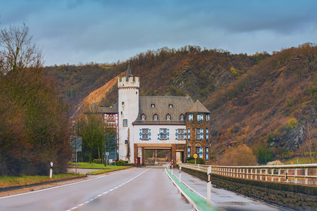 drive through: Castle of the Leyen, road passing the castle near Kobern Gondorf on the Moselle River, Germany.