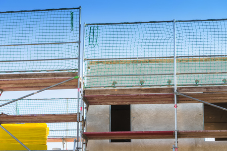 scaffolds: The construction of a settlement with turnkey prefabricated houses.Prefabricated house under construction Stock Photo