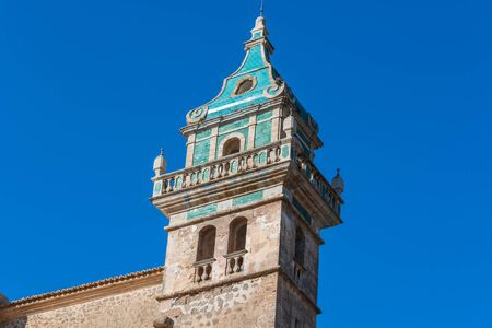 frederic chopin: Beautiful view. Tower of the Monastery of Valldemossa in the Sierra de Tramuntana Mountains with park. Stock Photo