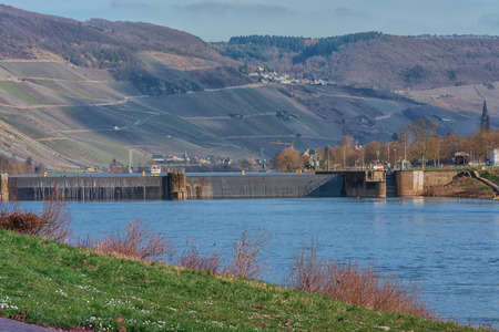 Landscape with river and sluice on the Mosel in Germany Stock Photo
