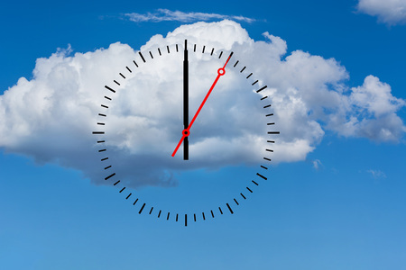 seconds: Clock, dial with a minute hand and a red second hand indicates 12 oclock. Copy space in front of sky and cloud background.
