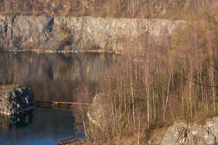 Panoramic view of an old open opencast mine of limestone works in Wuelfrath, Germany on a winter day.