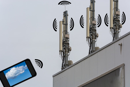 Antenna, telecommunications tower on a roof. Wireless telecommunication concept, home control by smartphone.