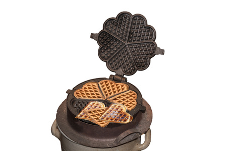 batters: Antique cast iron waffle maker for the open fire place.